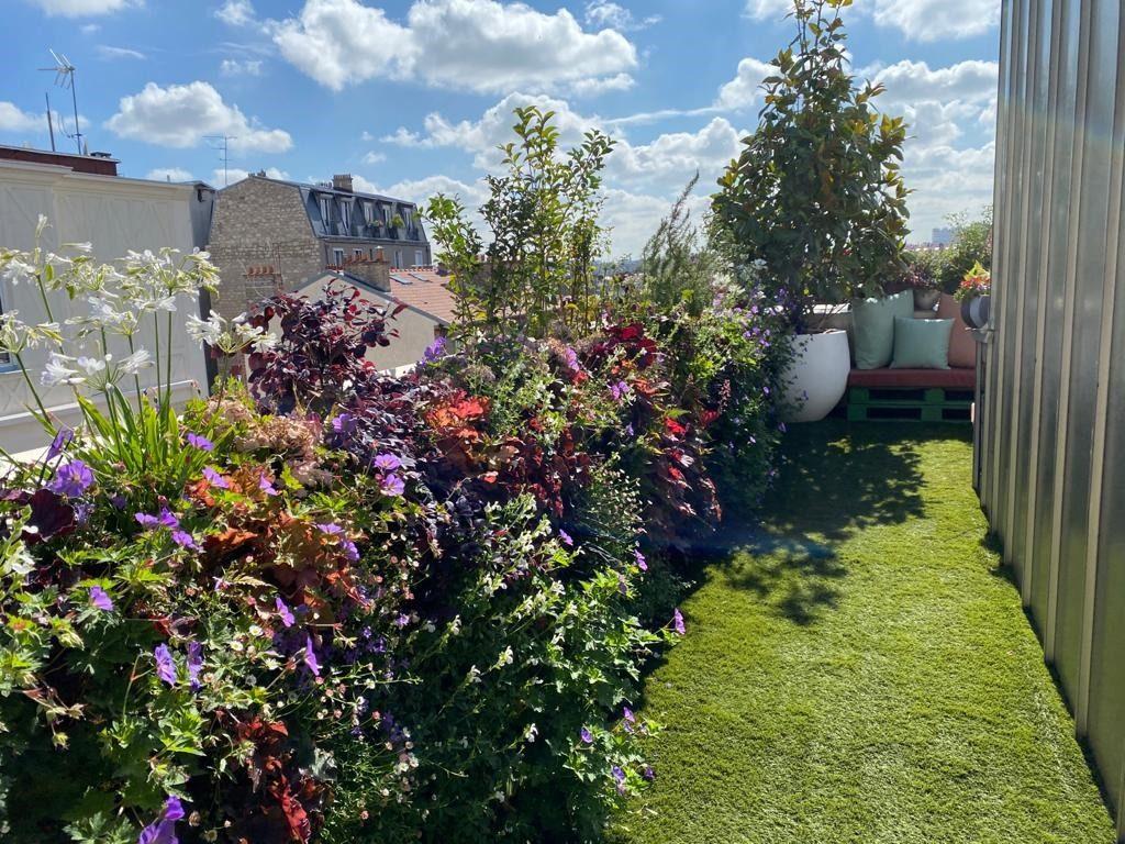 Aménagement paysager d'un balcon par Terrasse et Jardin de Paris